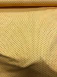 Tricot geel met oranje stip